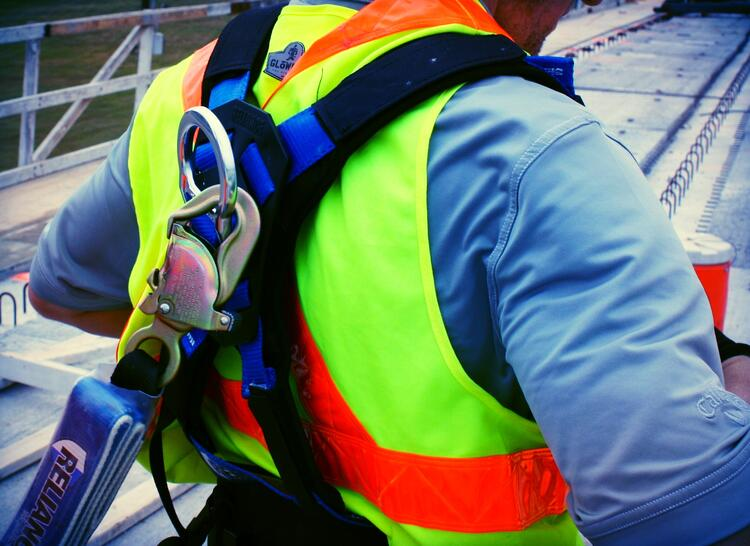 Worker using Reliance fall harness
