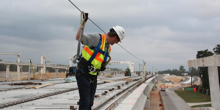 Constructon worker using fall protection