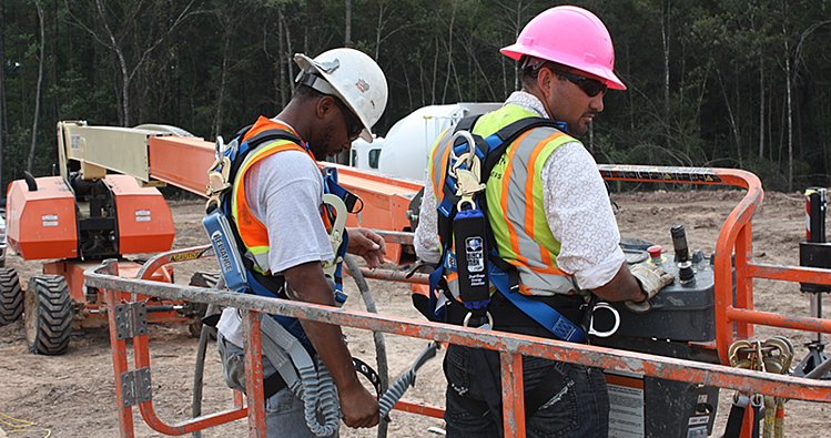 Two Workers Wearing Fall Protection on Aerial Lift