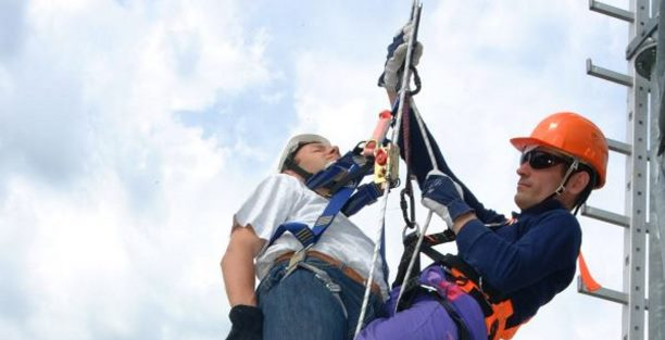 rescuer assisting fallen worker