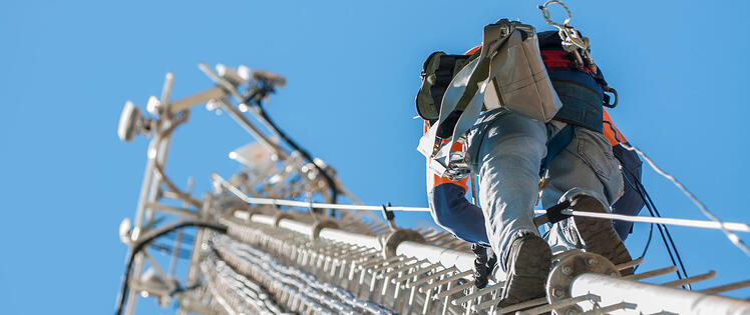 Worker climbing a cell tower