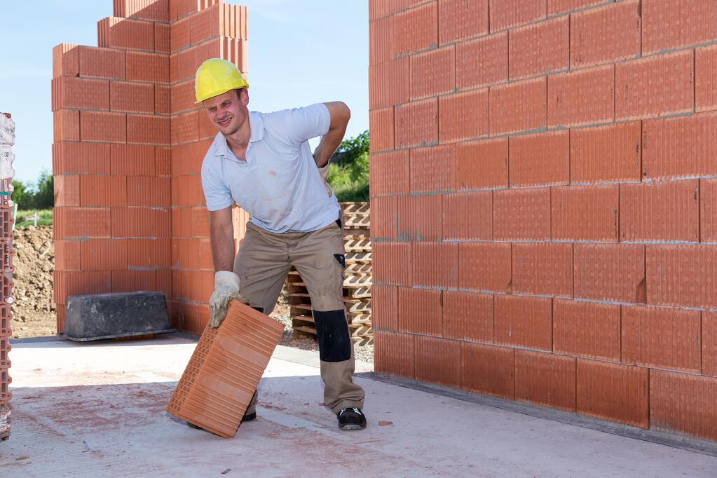 Construction worker with aches and pains